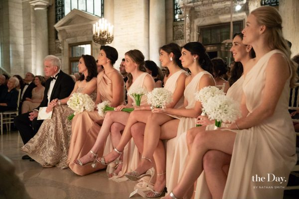 Bridesmaids seated during a wedding ceremony at The New York Public Library planned by Leslie Price of In Any Event NY.